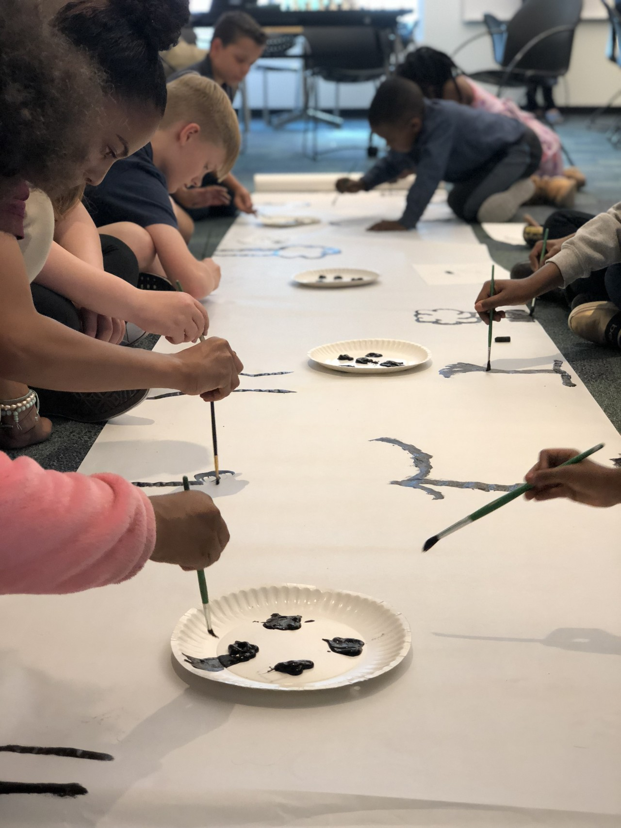 Bilingual arts and crafts classes are offered for babies, young children, and their parents in the Denver Public Library.